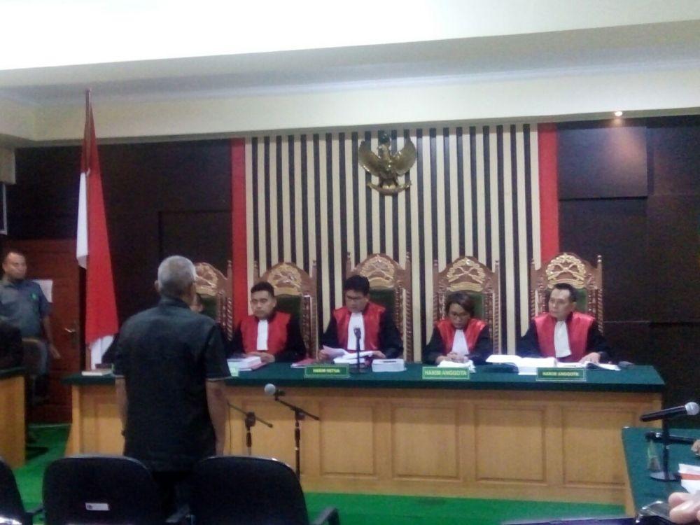 Arfan saat bersiap mendengarkan vonis  hakim