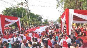 Ribuan Masyarakat Bungo Arak Bendera Raksasa Sepanjang 240 Meter, Ini Penampakannya