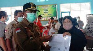 Mashuri Dampingi Ketua DPRD Edi Purwanto Pantau Penyaluran BST dan PKH di Merangin